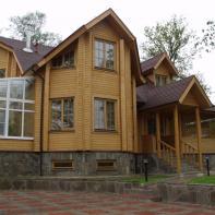 Дом из клееного бруса двухэтажный с террасой и зимним садом