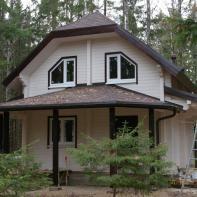 Дом из профилированного бруса двухэтажный белый